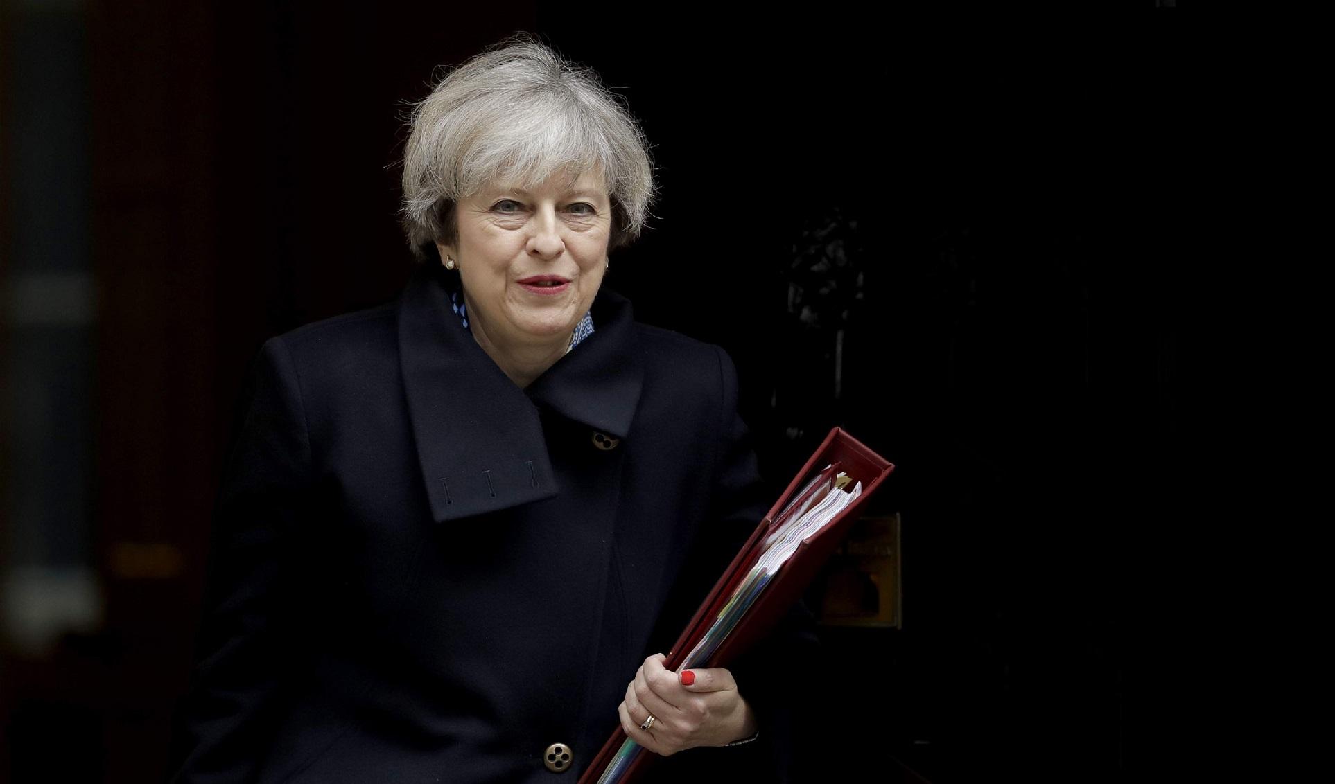 Theresa May. D. R.