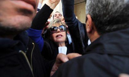 Assoul prise à partie par des partisans du FIS à sa sortie du tribunal d'Alger